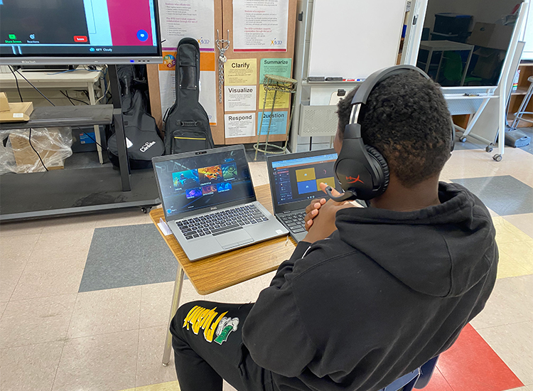 Young student looking at a laptop